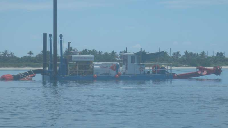 Guana Cay:Dredging sand at Bakers Bay
