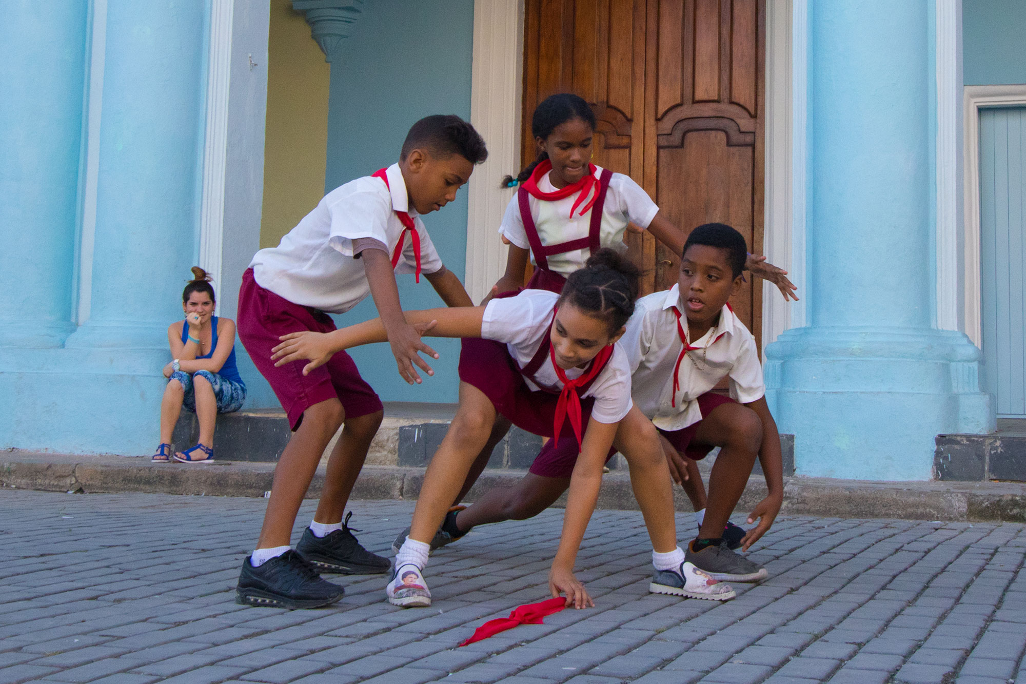 Schoolchildren play the game of Pañoleta in Havana, Cuba