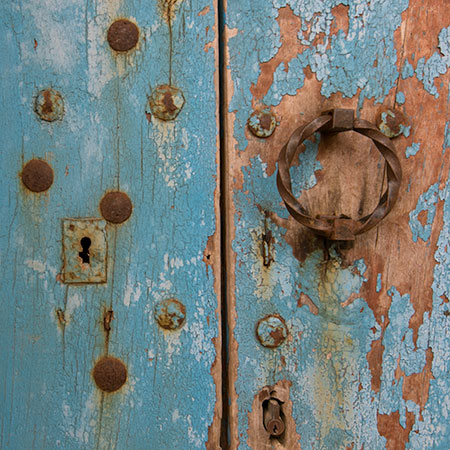 Rusted Keyhole on Blue Door